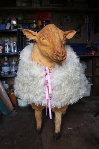 """""""Lamby"""" the chainsaw carved sheep wearing a felted fleece jacket, fully lined and reversible, made from 3 Texel x Herwick fleeces.  Yes, you heard right, 3 fleeces!  Lamby is a big sheep!"""